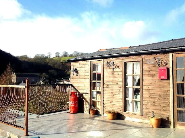 Welcome to our cwtch, a cosy, quirky timber lodge, that is a lot more than it looks!
