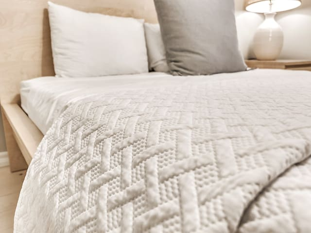 Cozy queen bed and bedding