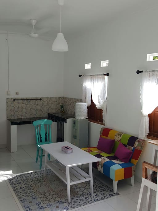 Small and warm living room and mini kitchen
