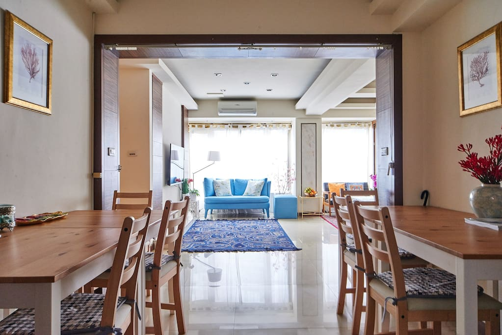 Dining area. Bright, lush and very spacious living room with multiple sofas for 16 guests
