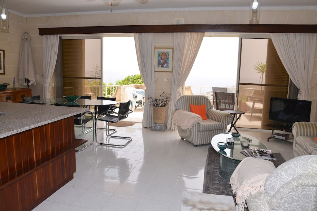 Living area leading to terrace and garden.