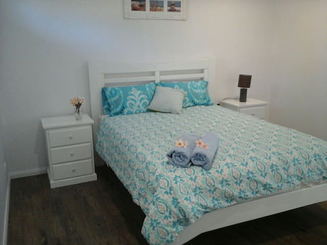 Main bedroom , high quality queen size pillow top mattress.