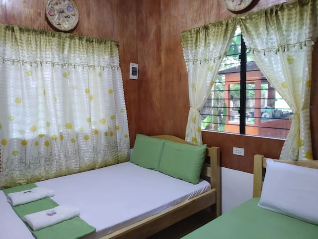 Our cozy airconditioned room with 2 double size beds.