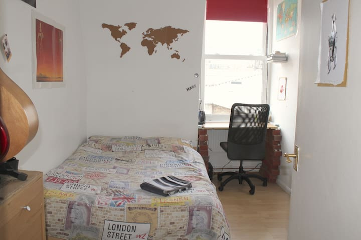 Jerry's bedroom in a homely Brick Lane flat