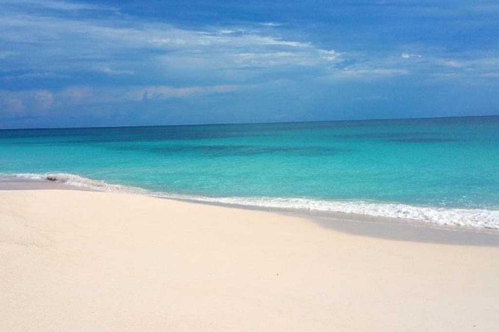 Walk for miles on our secluded pink sand beach