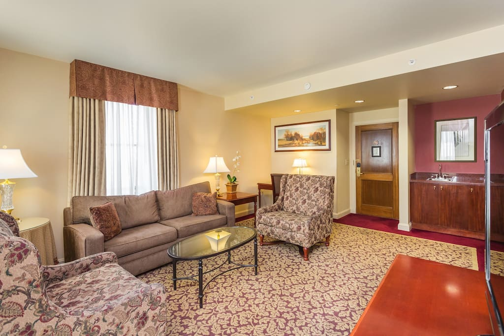 The sitting room is furnished for contemporary comfort while watching TV, or engaged in conversation.
