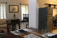 The dining table with a view of the kitchenette
