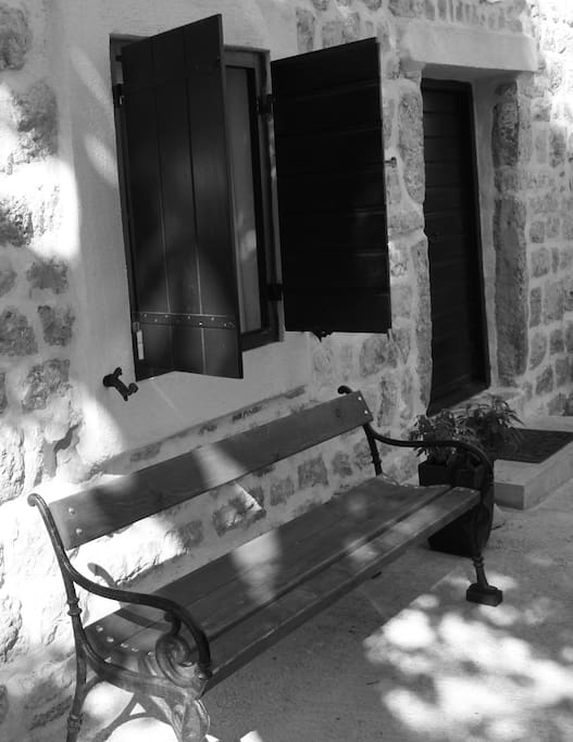The downstairs entrance to the house with lovely sage plants and a bench to sit and ponder