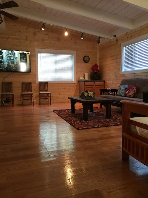 "2nd floor living room with foosball game table and another 60"" TV set, foosball game table, 2 fultons, free wifi, free Netflix movies, chromecast, etc."