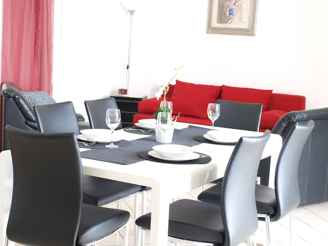 The living room with dining table