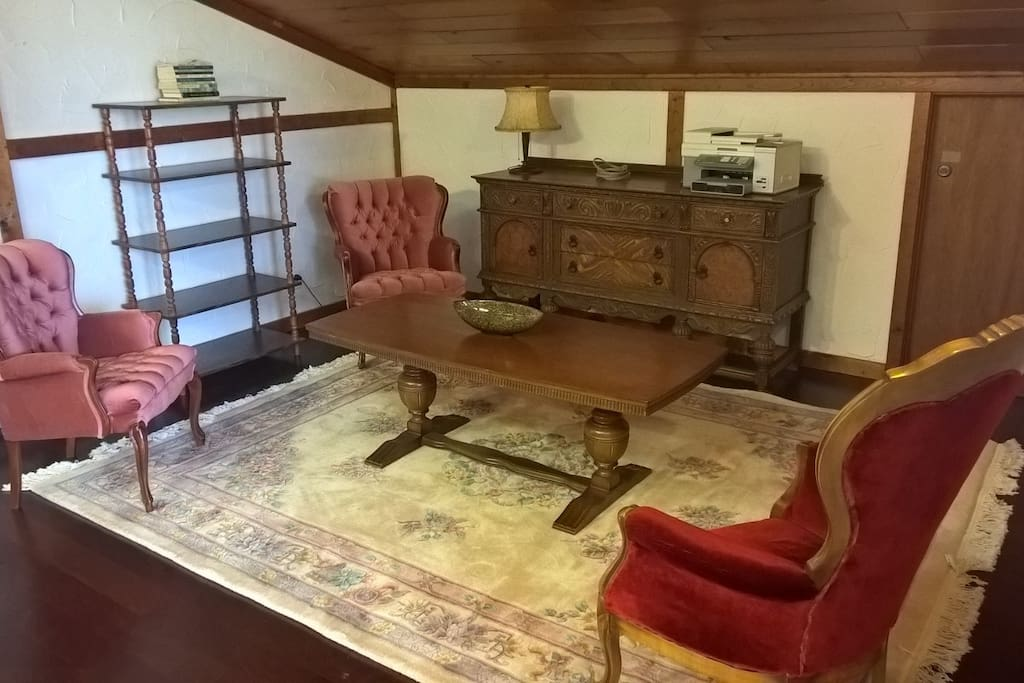 Antique furniture, German carved coffee table and hand knotted and cut rug.