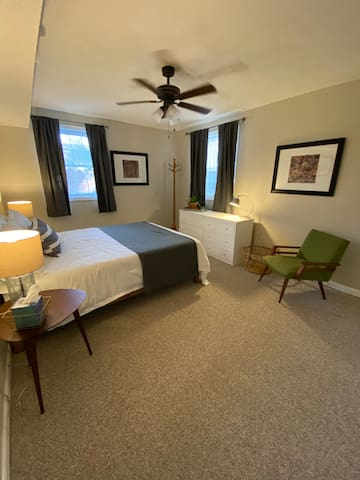 Large bedroom with queen bed and double closets.