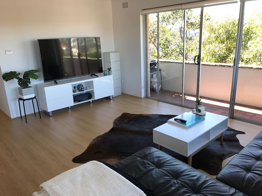 Open Plan Living Room with Wonderful Natural Light opening on to Balcony with great views across the Tasman Sea