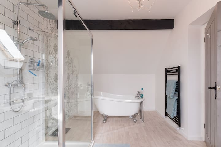 A view of the Freestanding Tub Bath with  Bubble Bath and soft fluffy Towels- perfect to unwind in after tackling Stroud's Hills.