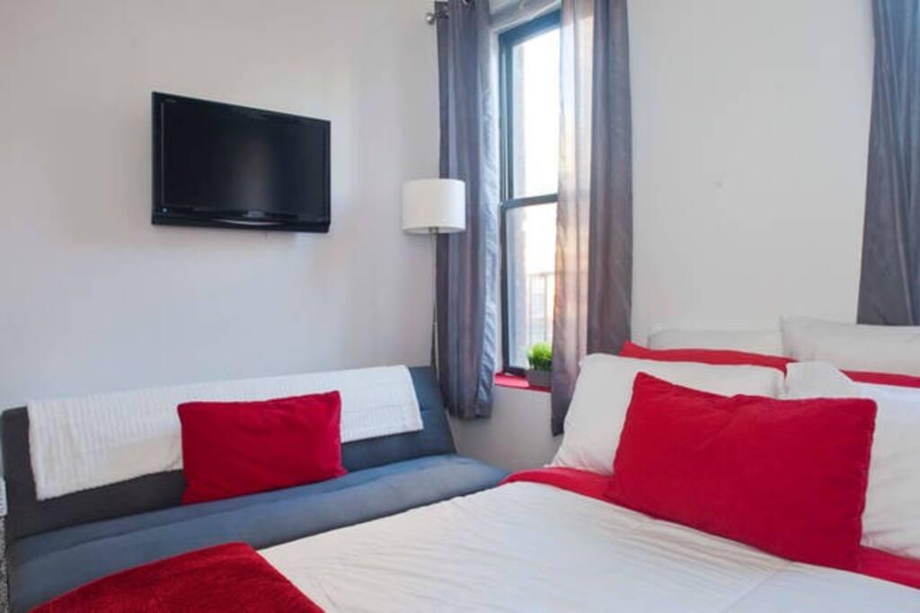 futon bed in master bedroom
