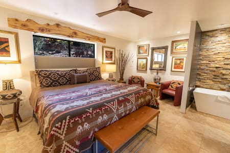 The guest bedroom has a king bed, spacious closet, armoire with HDTV and iPod dock.
