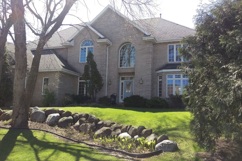 Beautiful McMansion on wooded lot facing west on a hill.