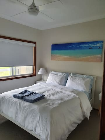 Master bedroom with a built-in robe, block out blinds and a very comfortable Queen size bed with very nice linen.
