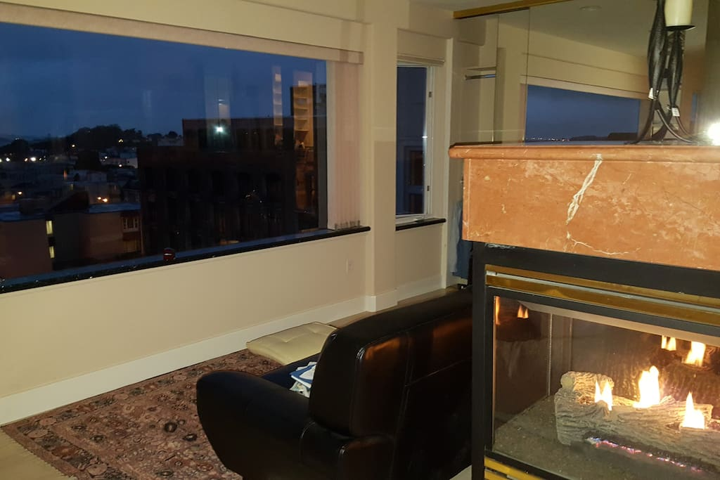 Gas fireplace with panoramic views of  Golden Gate Bridge, the city, the Bay and Angel Island