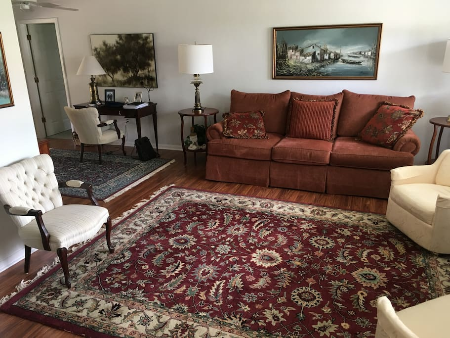 Comfortable living room with desk for business/personal affairs.