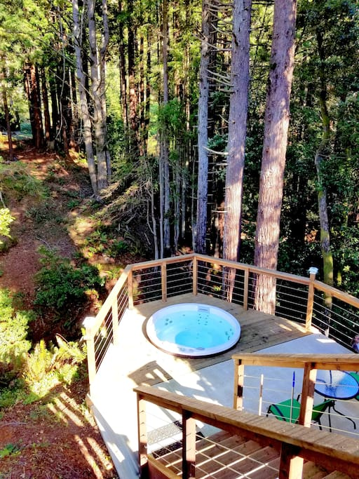 This amazing hot tub is surrounded by the nature, redwoods, creeks and pond!  It was built on the unthinkable location...13 steps down from the upper deck.