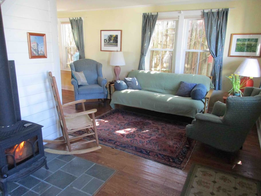 Heat from the little wood stove warms the living area.