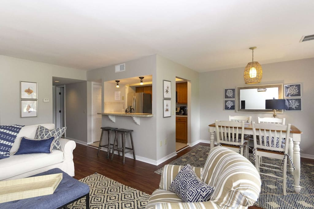 Comfortable and Casual living area.  Perfect place to relax after a day of golf, beach or pool - you choose!