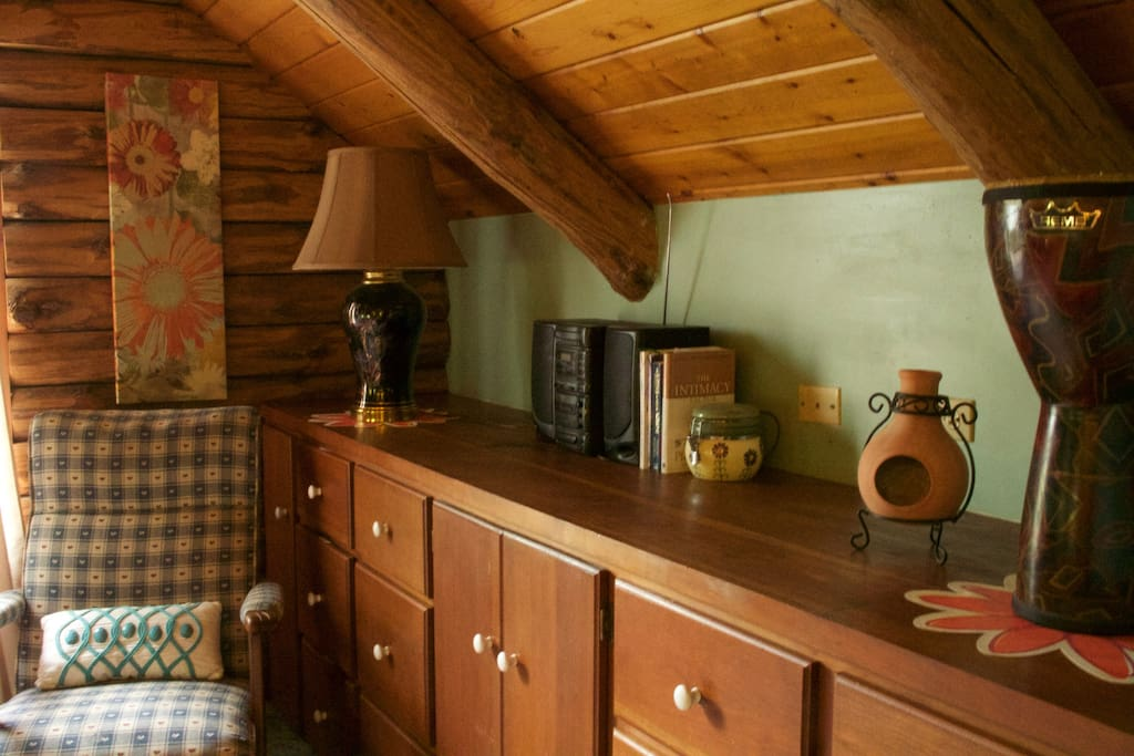 Handsome log interior room with cherry built ins and vaulted ceiling creates warm and cozy yet roomy feel.