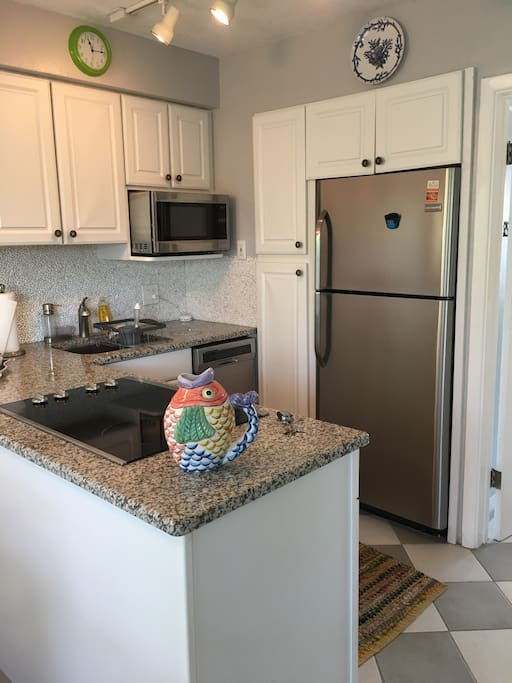 Cooktop, dishwasher, microwave, and refrigerator