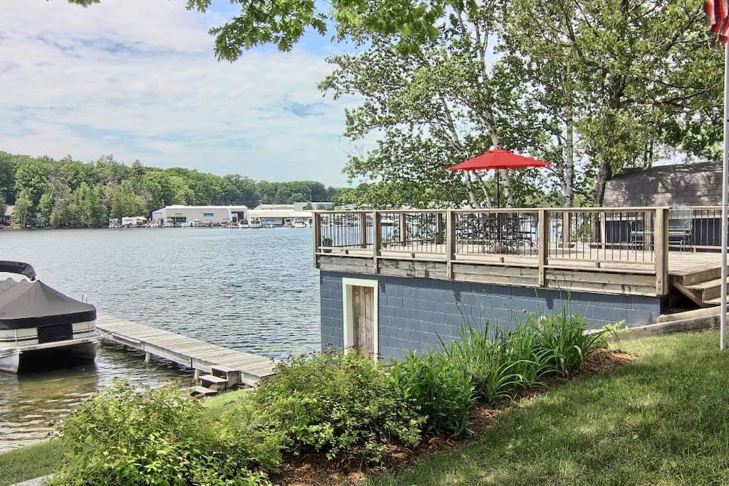 The deck above the boathouse is perfect for outdoor meals, watching the boats float by, and sunsets.