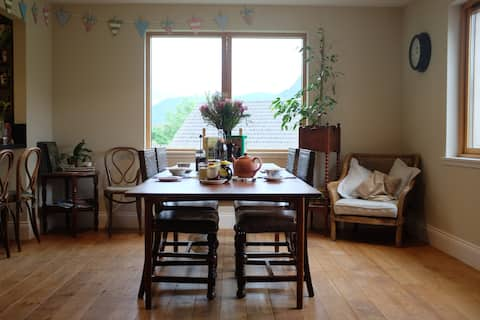 The dining room with table set for breakfast.
