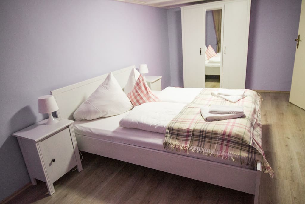 Comfortable quine-size double bed and wardrobe in the bedroom