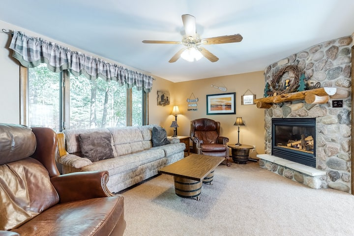 Classic, dog-friendly condo w/ a gas fireplace & furnished patio - walk to lake