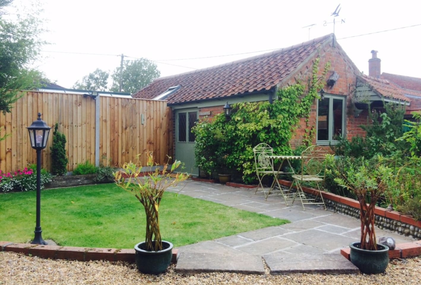 The annexe has its own courtyard and garden.