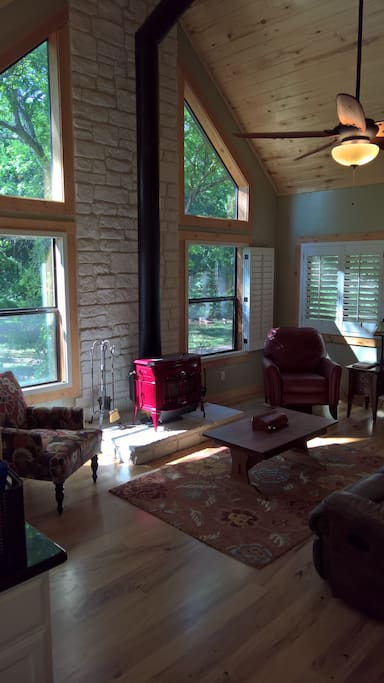 living room has a wood stove, leather sofa, recliner, etc.