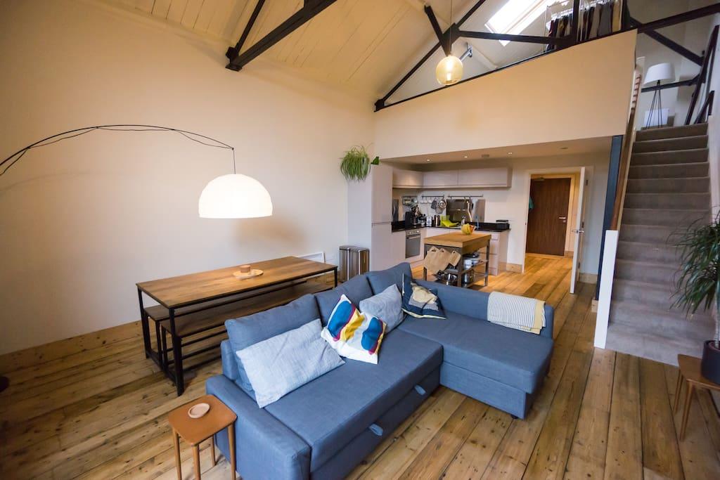 Open plan living area with mezzanine bedroom above