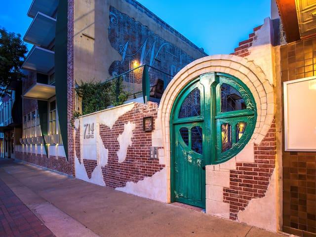 Namesake Green Door.  Entry from Austin Avenue to courtyard. Stanton Studios custom creation.
