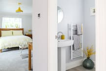 The spacious room has an ensuite with walk-in double shower.