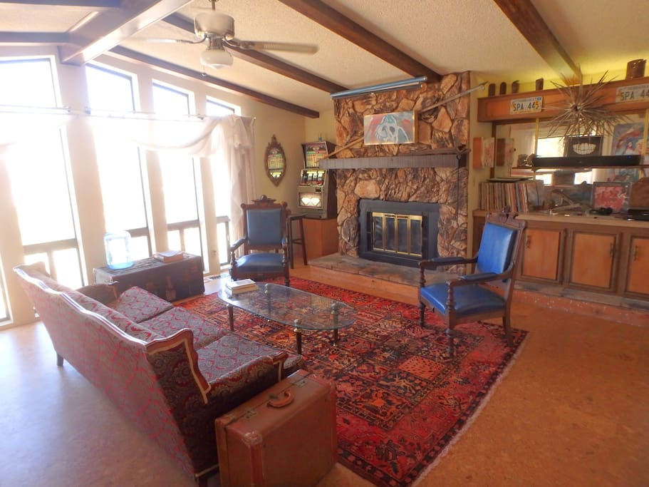 Living Room has six ceiling-to-floor windows (church-like?) facing north into the valley