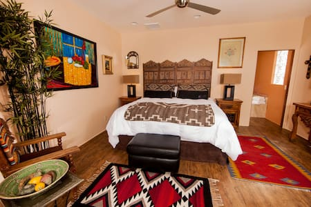 The master bedroom has a king bed, HDTV, IPod dock, spacious closet, and beautiful red rock views through the living room.
