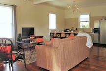 Open area for eating and entertaining! Large coffee table perfect for gathering around the TV!
