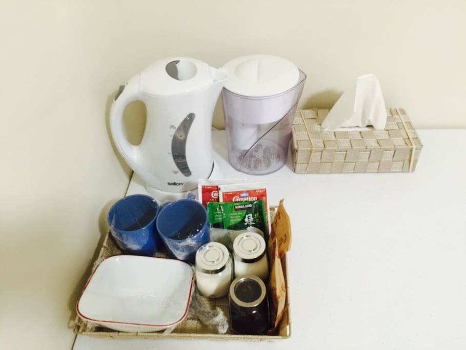 Hot water kettle and Brita pitcher. Hot Chocolate, oatmeal, tea and coffee at bed side.