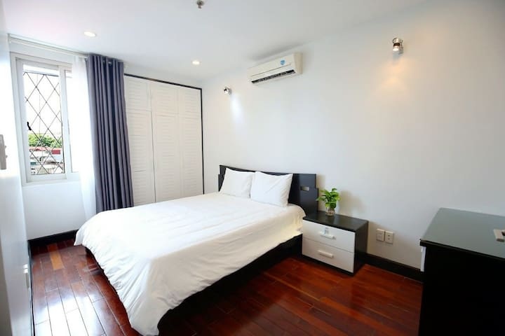 Warmly and nature light come in bedroom with 2 closets. Nice View