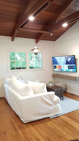 Upstairs living room area with smart TV.