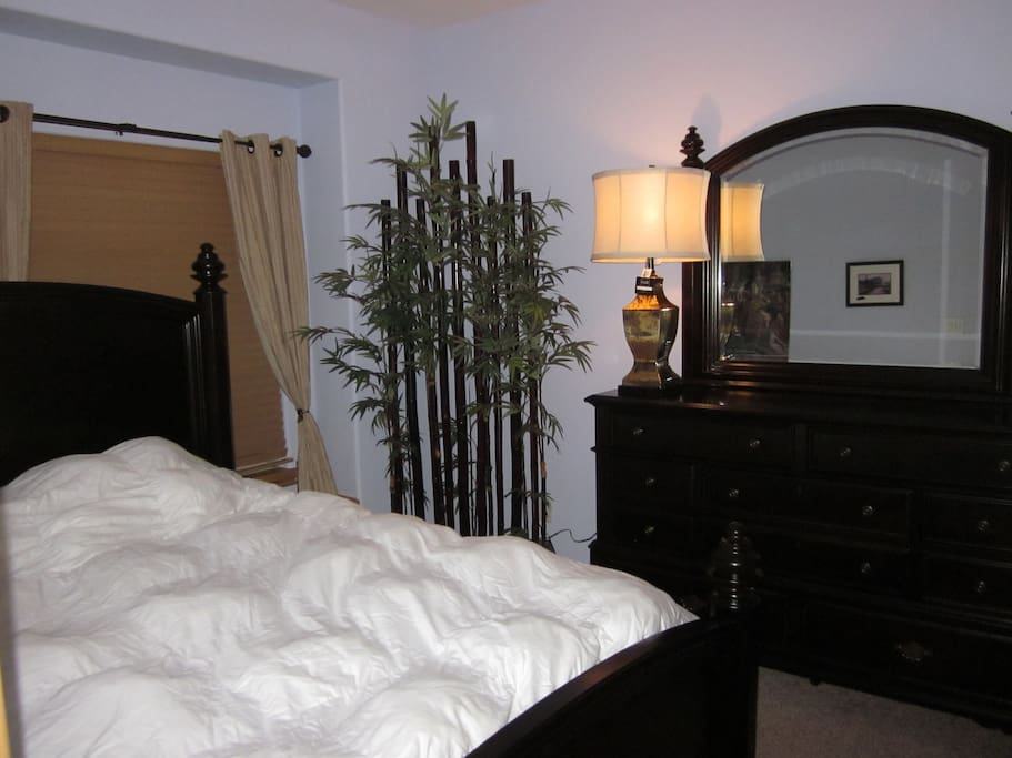 Feel like royalty with plush pillowtop queen bed in the bamboo room.