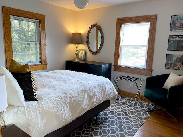 Bedroom with queen pillow top mattress and down comforter