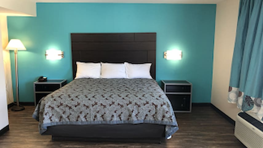 King Bed with private Bath. Laminated floor with Mini Microwave and Refrigerator.