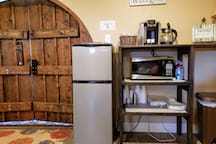 The room also contains a small kitchenette.   A mini-refrigerator, microwave, coffee, and plastic dinnerware are provided.