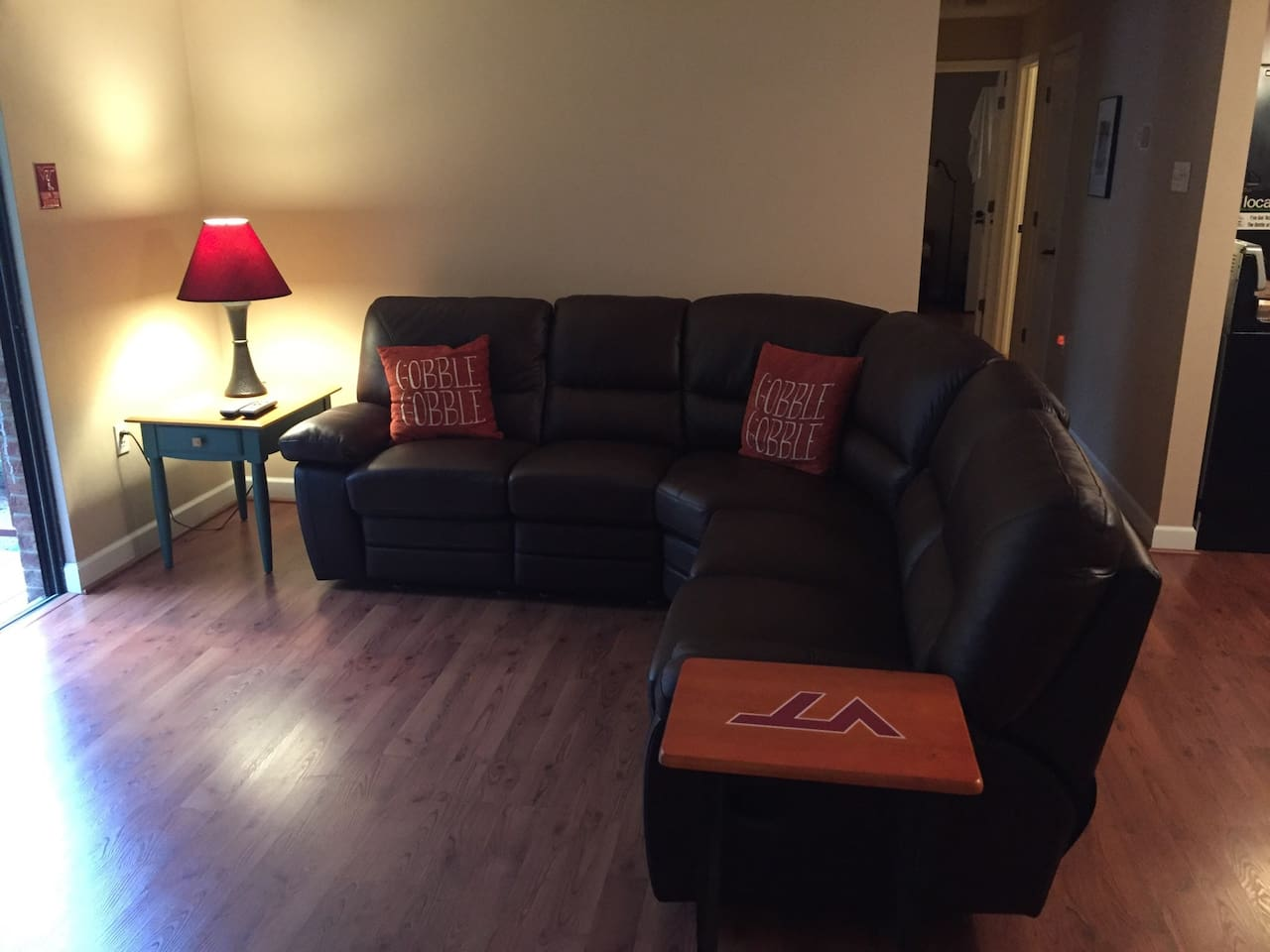 Comfy leather sofa.  Both ends are a recliner.  Look for handle on the sides.