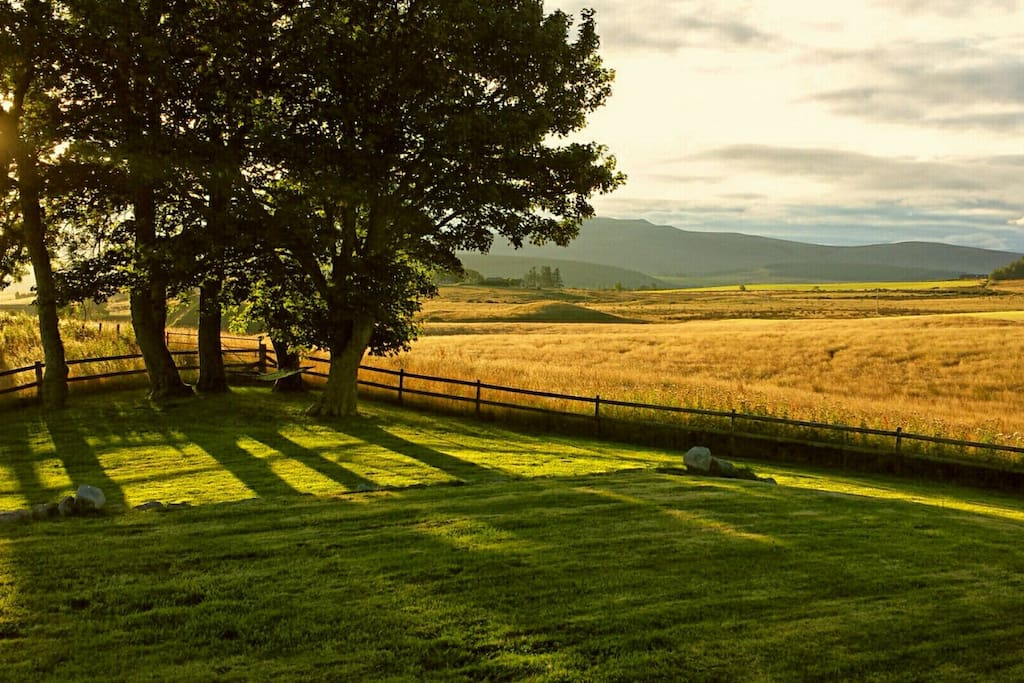 Autumn sun. View from the front garden as the sun rises over Ben Rinnes.